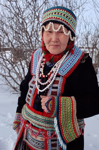 Ekaterina, an Even woman from Gizhiga, wearing traditional Even dress. Northern Evensk, Magadan Region, E. Siberia, Russia