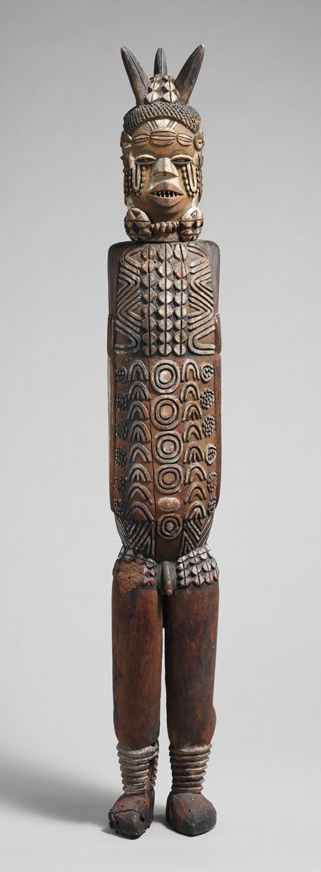 Africa | Three-Headed Standing Figure, from the Kuyu peoples of the Congo River Basin region of the Republic of Congo | 19th century | Wood and pigments.