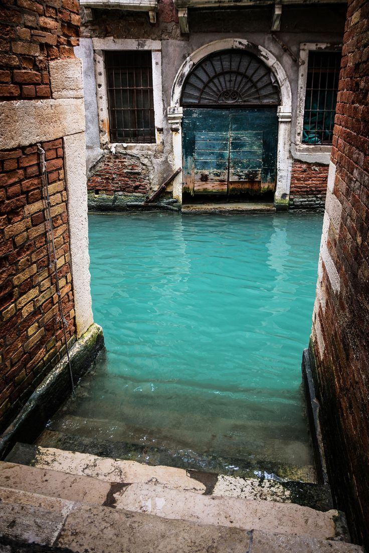 Turquoise Canal in Venice, Italy. From