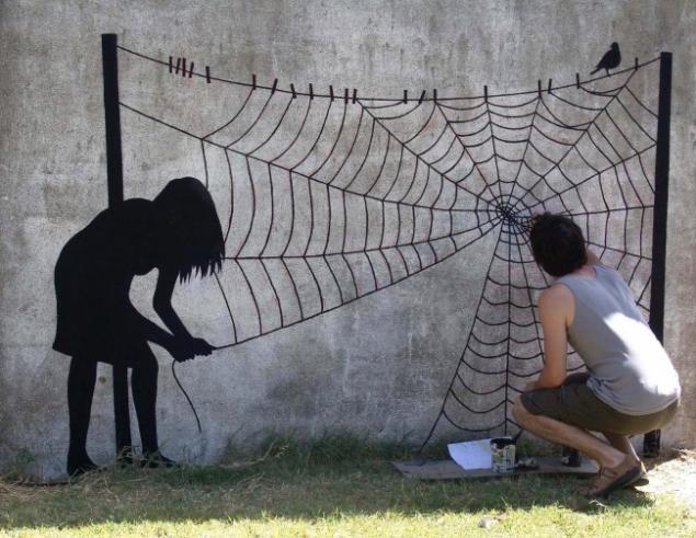 Рисунок на стене на улице