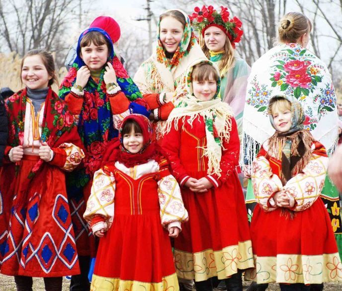 Russian girls in their national costumes are watching the performance at one of the folk festivals.