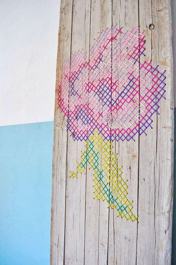 Cross stitch flower on wood