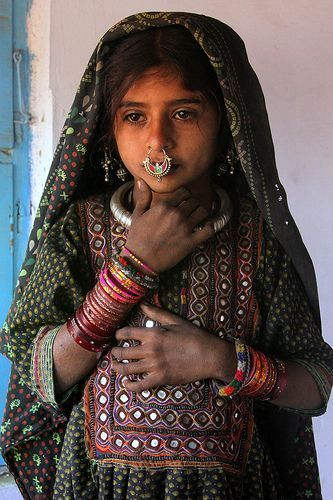 Dhaneta Jat Girl by Retlaw Snellac via flickr. The Jat is one of the hidden tribes in Gujurat, India. They migrated from Iran 500 years ago searching for new grazing land for their cattle. The Dhanetas are the largest of the Jat Communities. They are Muslim.