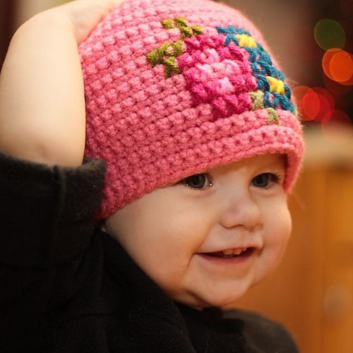 Mamachee offers a free crochet pattern for this hat that has a cross stitch pattern on it