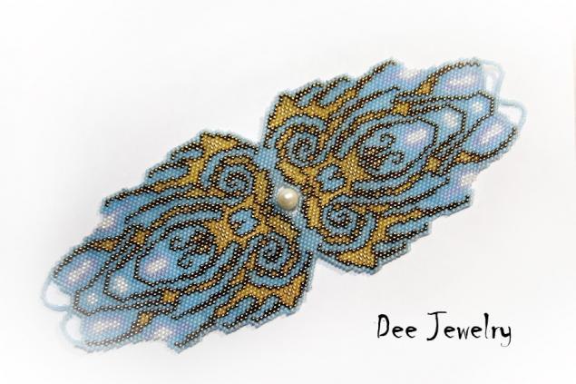 Фигурный браслет, выполненный в мозаичной технике из японского бисера Тохо мельчайшего размера и жемчужины.