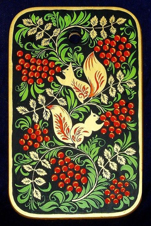 A wooden chopping board with folk Khokhloma painting from Russia. A pattern with squirrels eating Rowan berries. #art #folk #painting #Russian
