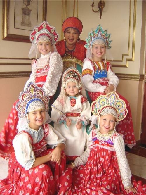 Traditional Russian costumes. I love the little girl in the middle. What a dumpling!