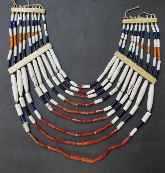 **Naga Jewellery. Naga Necklace made out of glass beads, conch shell, carnelian.