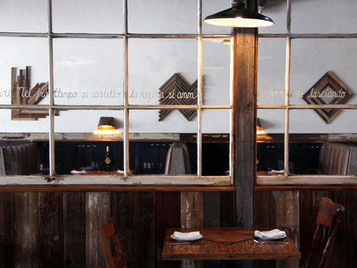 This twenty foot long interior window wall acts as a divider and a sound barrier, making sure the 2000 square foot restaurant remains comfortably quiet.