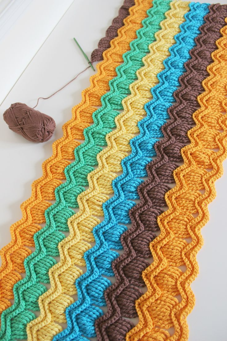 crochet fan ripple blanket --  at ravelry -- vintage fan ripple stitch -- be sure to look at projects for different colors.