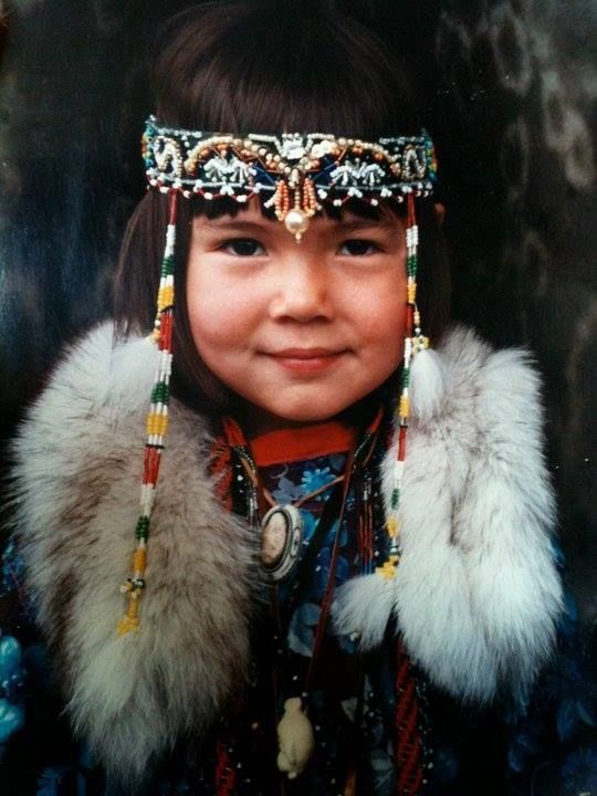 Native smille from a Sakha girl, Sakha (Yakutia) Republic, Northeast Siberia  -The Sakha (Yakuts) are a (semi-) nomadic Turkic people indigenous to Sakha (Yakutia) in Northeast Siberia.  In the 17th century ethnic Russians began to move into their territory and annexed it, imposed a fur tax, and managed to suppress several Sakha (Yakut) rebellions between 1634 and 1642. Russian brutality in collection of the pelt tax (yasak) sparked a rebellion among the Sakha and also Tungusic-speaking tribes.