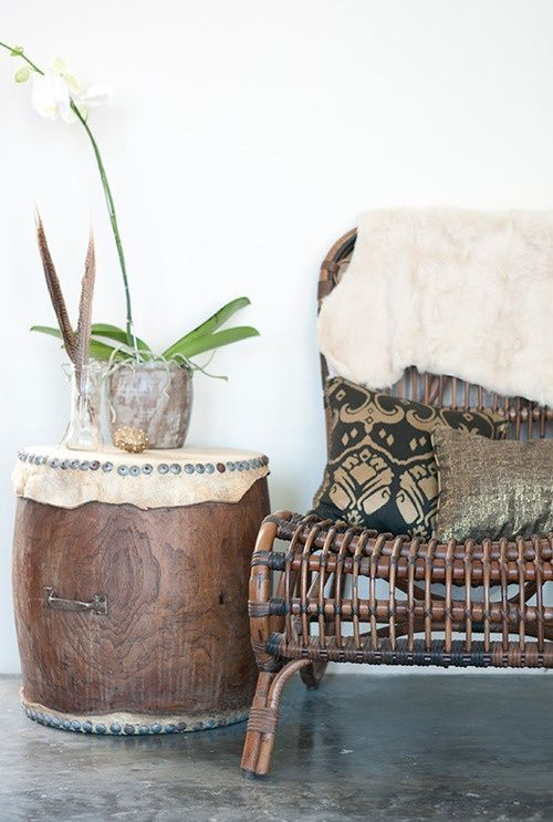 Filomena's Market - drum side table, wicker reed bamboo dark wood chair and dark throw pillows --- modern bohemian boho interior design / vintage and mod mix with nature, wood-tones and bright accent colors / anthropologie-inspired chic mid-century home decor
