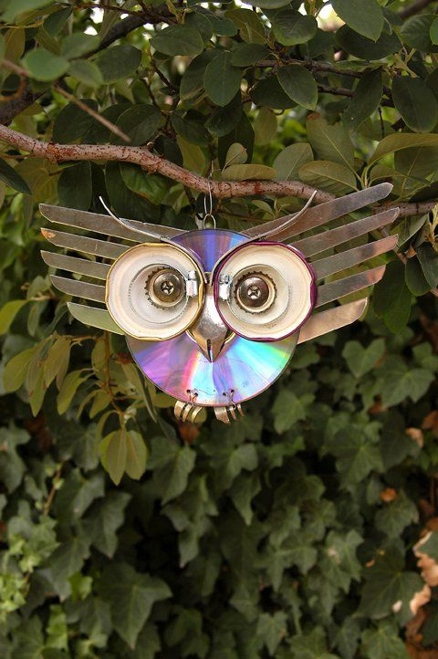 This kitchen owl was made from salvaged kitchen supplies and a CD which is reflective and can help keep birds from eatting your cherries. If you're lucky...at least it looks darling.
